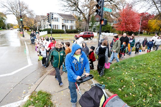 The corner of Division and Park was crowded Sunday, Oct. 28, 2018, during trick or treat in Fond du Lac, Wisconsin.