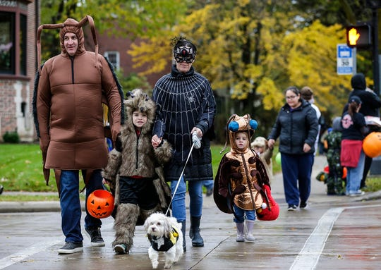 John, William, Amanda and Elizabeth Nash and their dog Rollie of Fond du Lac were out trick or treating Sunday, Oct. 28, 2018, in Fond du Lac, Wisconsin.