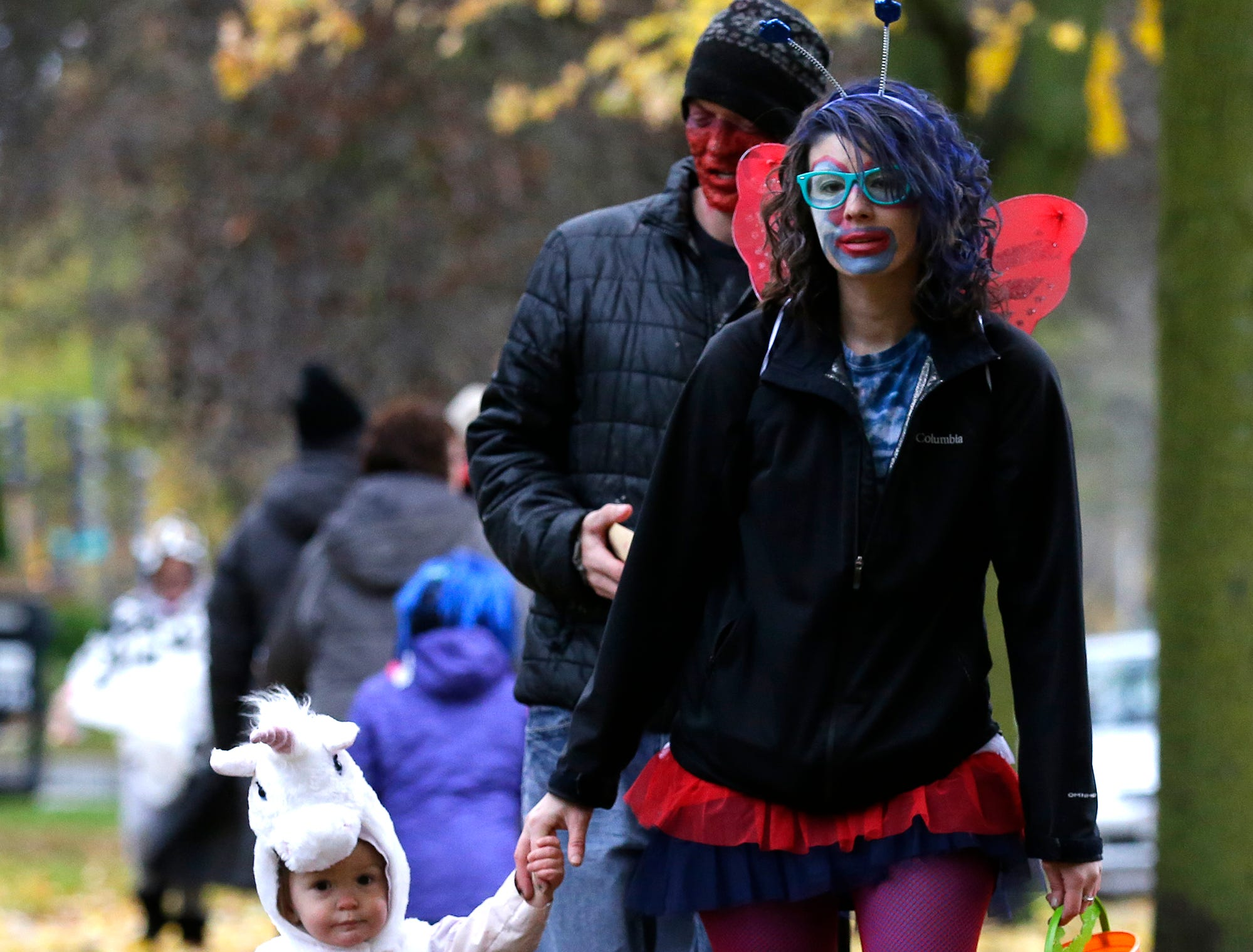 Olivia, James and Ashley Meilahn of Fond du Lac were out trick or treating Sunday, October 28, 2018 in Fond du Lac, Wisconsin. Doug Raflik/USA TODAY NETWORK-Wisconsin