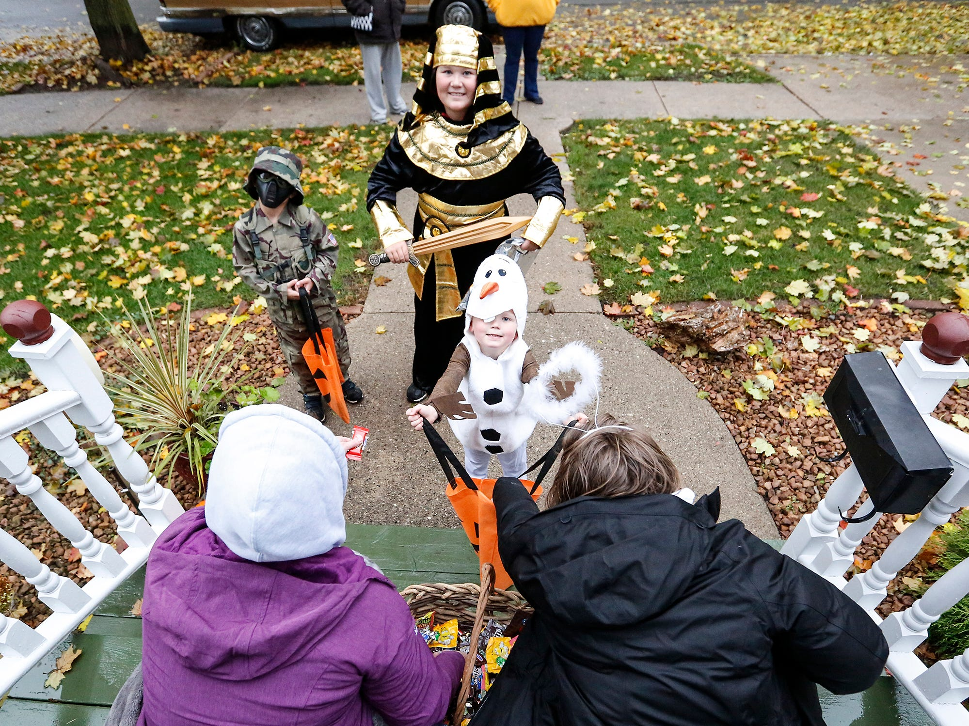 Zander Rushing, Thaddeus Becker and Jase Rushing were out trick or treating Sunday, October 28, 2018 in Fond du Lac, Wisconsin. Doug Raflik/USA TODAY NETWORK-Wisconsin