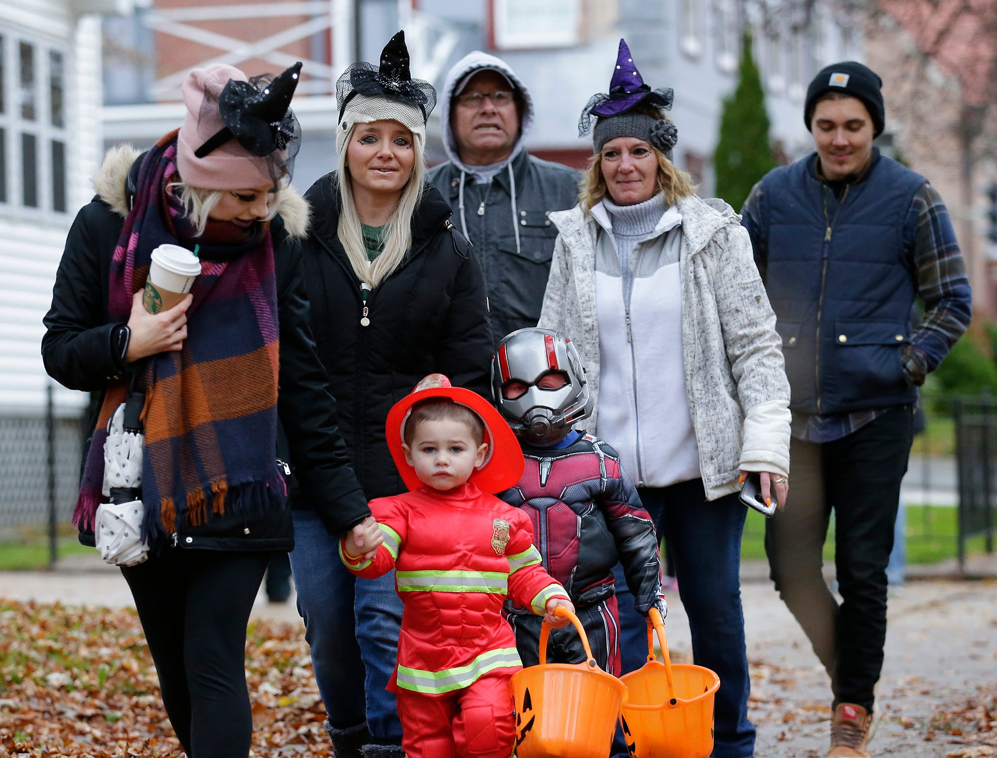 Hudson and Archer Sears trick or treat with aunts Mariah and Lacy Freed and grandma Pam Freed all of Fond du Lac Sunday, October 28, 2018 in Fond du Lac, Wisconsin. Doug Raflik/USA TODAY NETWORK-Wisconsin