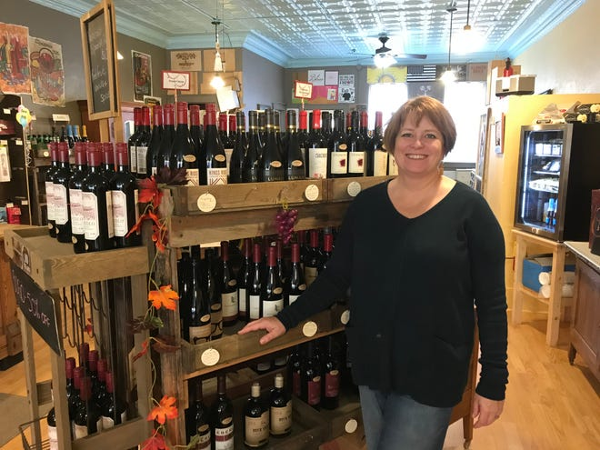 Sara Cujak in her store, Cujak's Wine & Coffee Bar, at 47 N. Main St. The store will close Dec. 1 as she takes on the role of sommelier at the Hotel Retlaw.