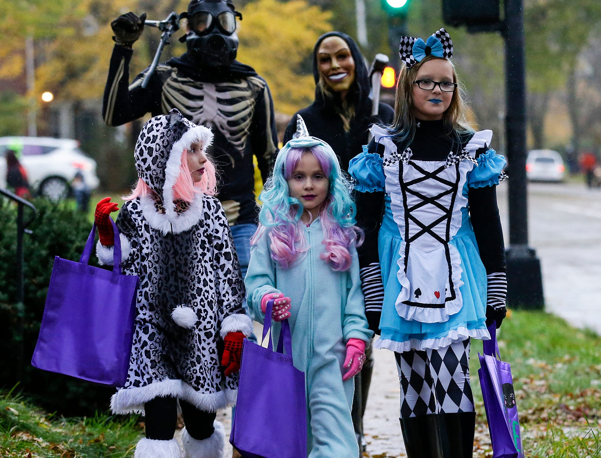 Pearl and Paisley Diorio and Nova Loppnow (front row) and Drew Diorio and Rose Barber of Fond du Lac were out trick or treating Sunday, October 28, 2018 in Fond du Lac, Wisconsin. Doug Raflik/USA TODAY NETWORK-Wisconsin