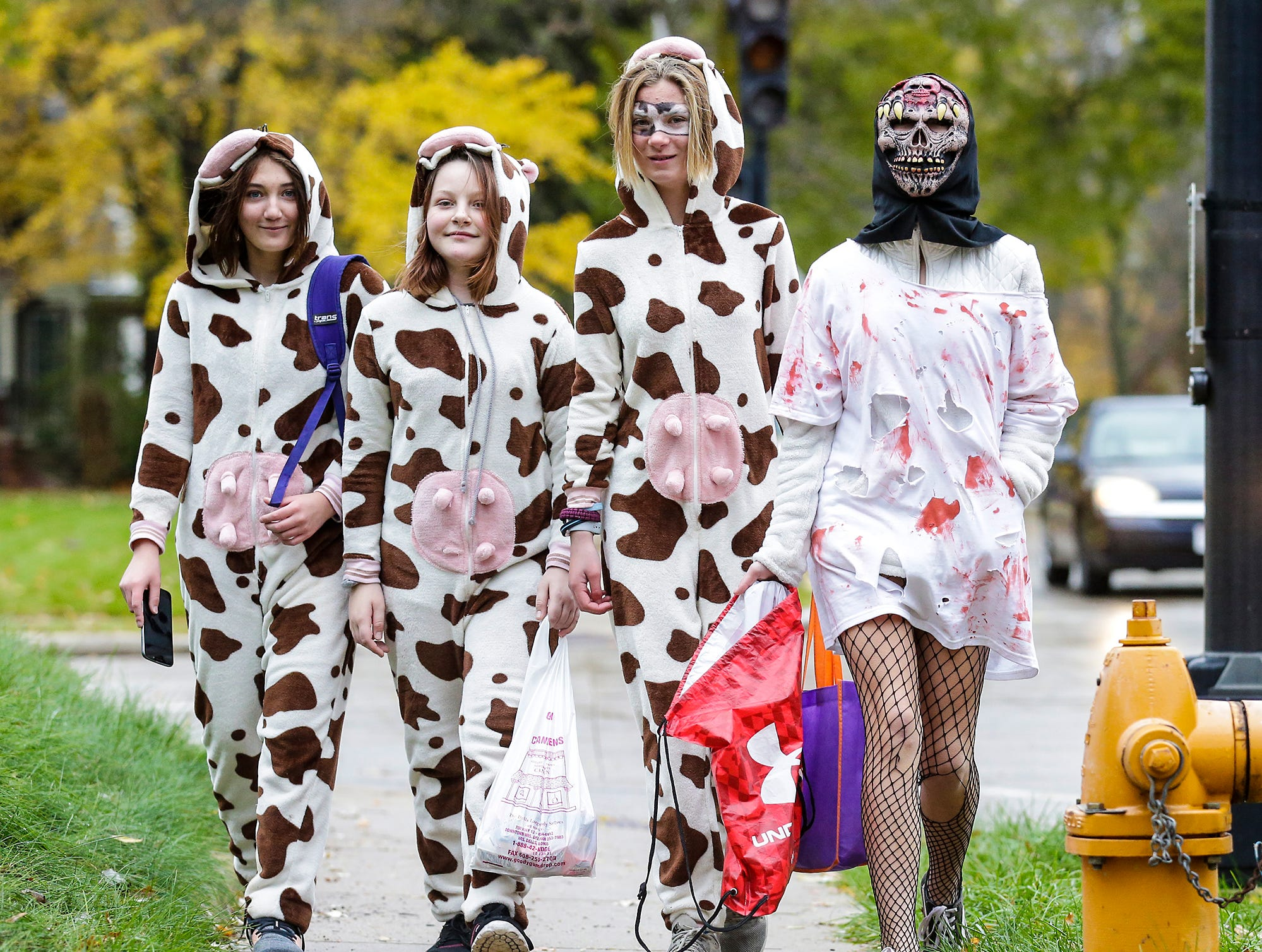 Kristina Molina, Alana Pierce and Olivia and Annamae Schnese of Fond du Lac were out trick or treating Sunday, October 28, 2018 in Fond du Lac, Wisconsin. Doug Raflik/USA TODAY NETWORK-Wisconsin