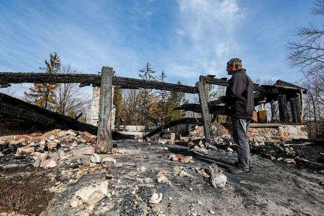 Camp Vista manager Andrew Fidziukiewicz looks over the remains of the camp church Thursday, October 25, 2018, after fire destroyed the building in the early morning hours of October 24. The church served as a chapel and meeting space for Camp Vista retreats and programs. Doug Raflik/USA TODAY NETWORK-Wisconsin
