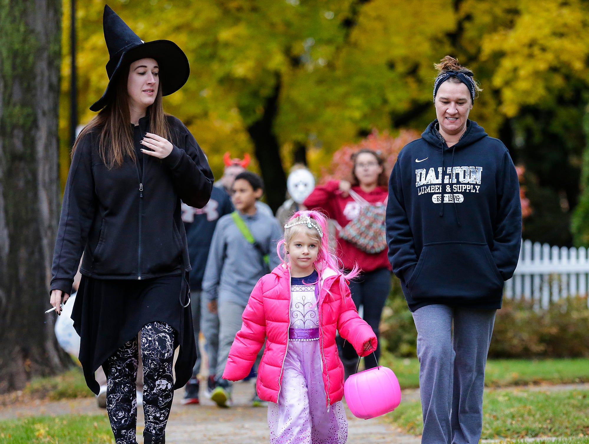 Brooke Siewert and Evelyn Kreuziger of Waupun and Shelley Bloch of Fond du Lac were out trick or treating Sunday, October 28, 2018 in Fond du Lac, Wisconsin. Doug Raflik/USA TODAY NETWORK-Wisconsin