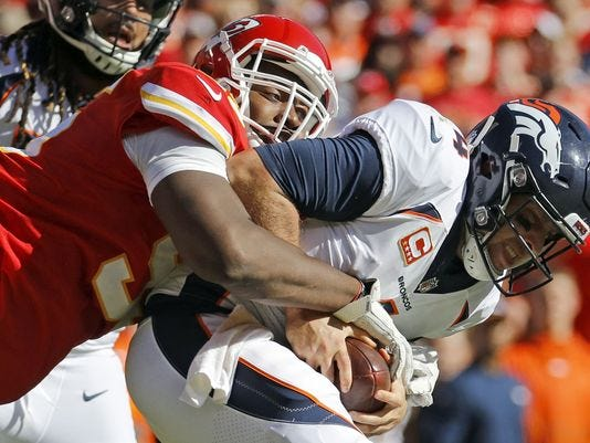 Kansas City Chiefs defensive lineman Chris Jones (95) sacks Denver Broncos quarterback Case Keenum (4) during the second half of an NFL football game in Kansas City, Mo., Sunday, Oct. 28, 2018.