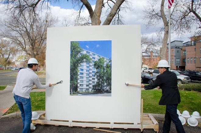 """A ceremonial """"wall breaking"""" recently at DMA Plaza, 127 units for lower-income residents age 62 or older. DMA Plaza will get a $16 million renovation beginning in January."""