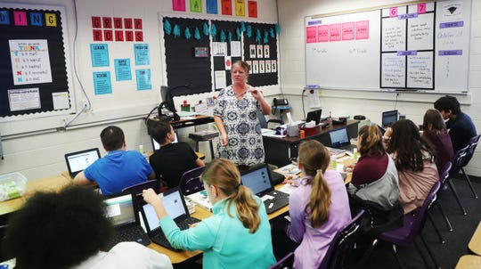 Katie Mills, a teacher at Cypress Lake Middle School teaches in a cramped classroom on Monday, Oct. 29, 2018.