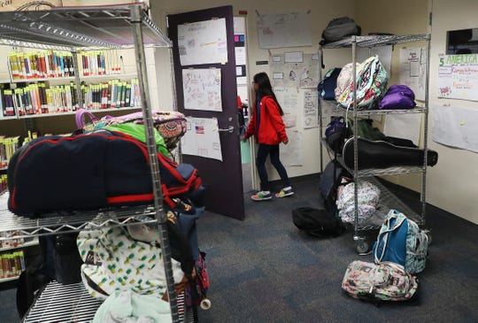 A Cypress Lake Middle School student enters a classroom on Monday, Oct. 29, 2018. Students have to leave backpacks outside the classroom because of a lack of space.