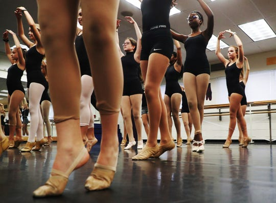 Members of a dance class at Cypress Lake Middle School take part in a lesson on Monday, Oct. 29, 2018.