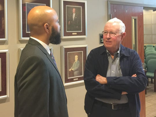 New Mauldin city administrator Brandon Madden talks with citizen Bud Greer after his appointment to the new role at a special called council meeting on Monday, Oct. 29, 2018.