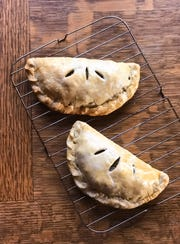 Pasties are meat and veggies wrapped up in pastry dough. They are Ieven better when smothered in brown gravy.