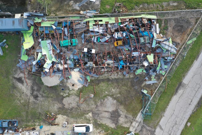 A drone photo of Bong Malasarte's business warehouse, cars and boats on Saipan that were severely damaged by Super Typhoon Yutu.