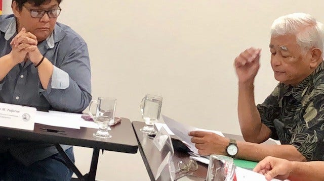 Guam Election Commission Joaquin Perez, right, addresses his colleagues during a Monday night meeting, while Chairwoman Alice Taijeron, left, looks on.