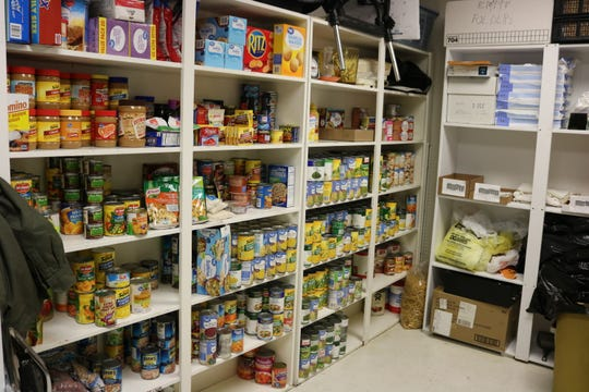 The food pantry fully stocked after receiving canned foods from students in Union County (not pictured is the other stocked side of the room).