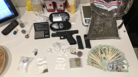 Drugs, gun, and cash found on Paul Courtney.