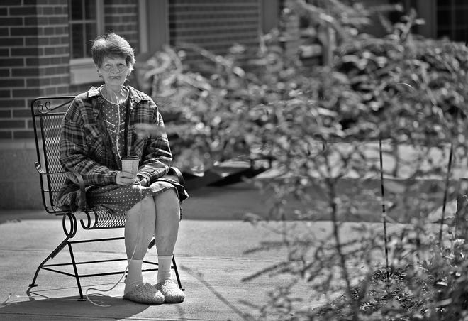 Dixie Hinz sits on her patio and watches the 14th Annual Memorial Remembrance service at Abbie Hunt Bryce, Sunday, Oct. 13, 2018. The service was in the patio area behind the residents' rooms. The hospice is for the terminally ill who have nowhere else to go and are without financial resources. 19 residents who passed away during the year were remembered during the service.