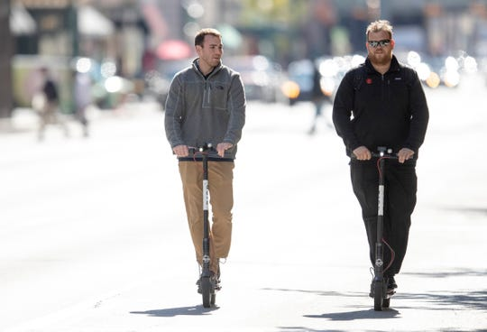 Scooters being ridden in downtown Indianapolis on a brisk Fall day, Monday, Oct. 29, 2018.