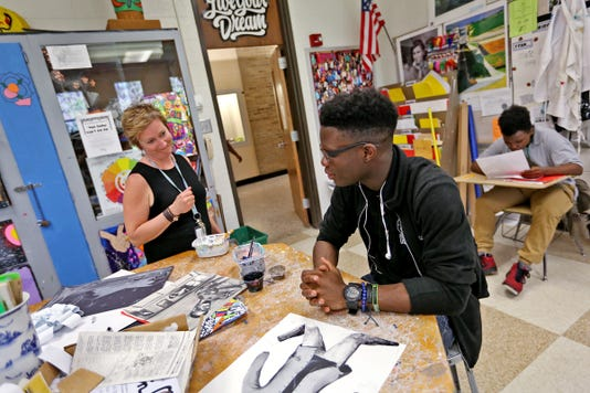 Northwest High School teacher and student in Indianapolis