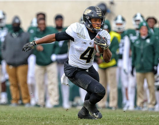 Oct 27, 2018; Purdue Boilermakers wide receiver Rondale Moore (4) runs the ball during the second half of a game against the Michigan State Spartans at Spartan Stadium.