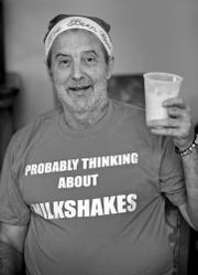 "Richard Duarte shows off his ""Christmas present"" t-shirt and a milkshake during the Christmas in July party at Abbie Hunt Bryce Home, Wednesday, July 25, 2018.  The home offers hospice for the dying poor.  It also offers a place to recuperate for Eskenazi patients who are homeless or poor, and need a little more help before going back to their lives.  Duarte died at the home Oct. 14, 2018."