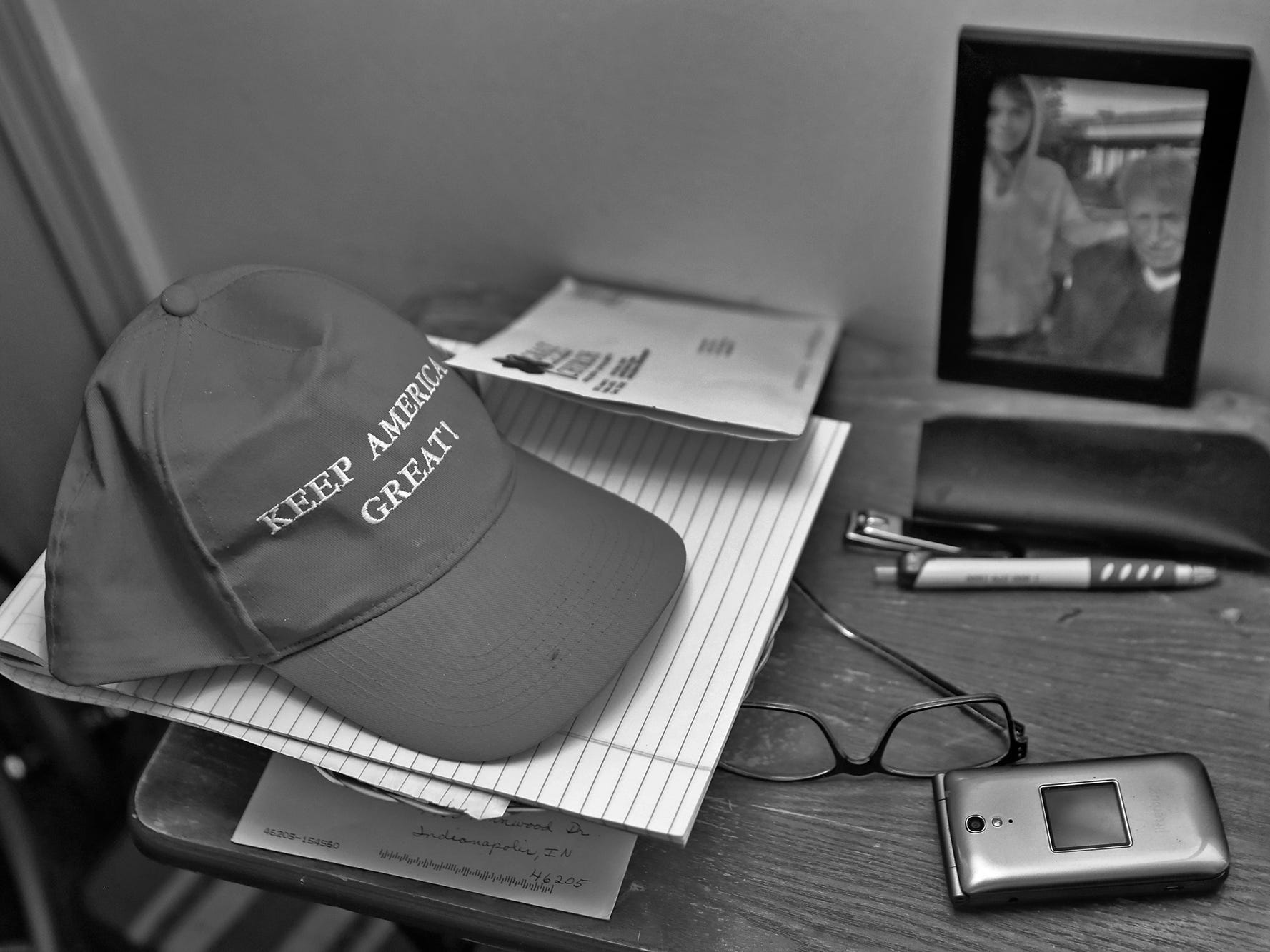 """Dewey Logeland keeps his """"Make America Great!"""" hat on table in his room at the Abbie Hunt Bryce Home, Wednesday, July 11, 2018.  Logeland moved to the Abbie Hunt Bryce Home in 2018.  The home offers hospice for the dying poor."""