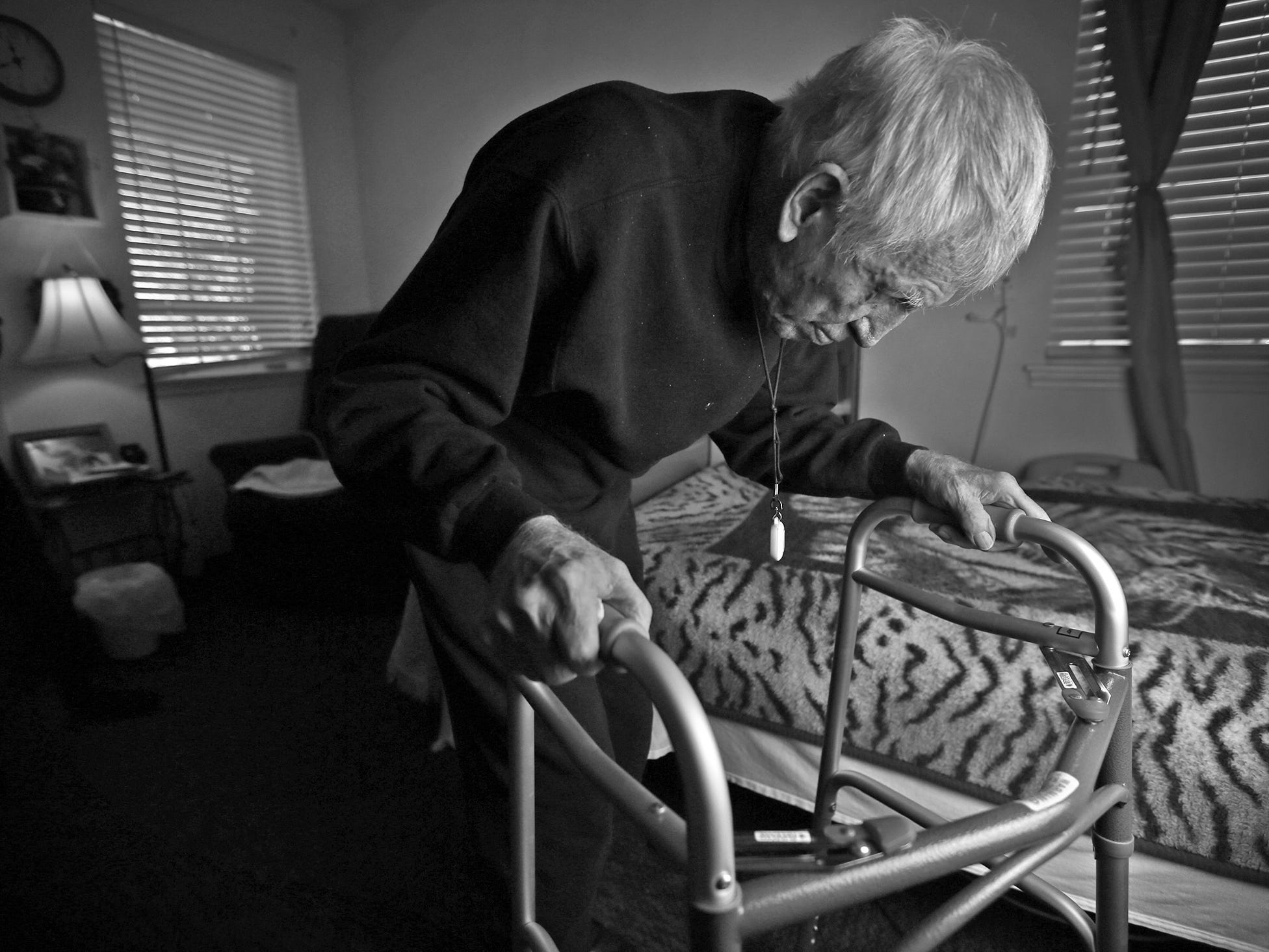 Dewey Logeland walks to his bed in his room at the Abbie Hunt Bryce Home, Friday, April 20, 2018.  The home offers hospice for the dying poor.