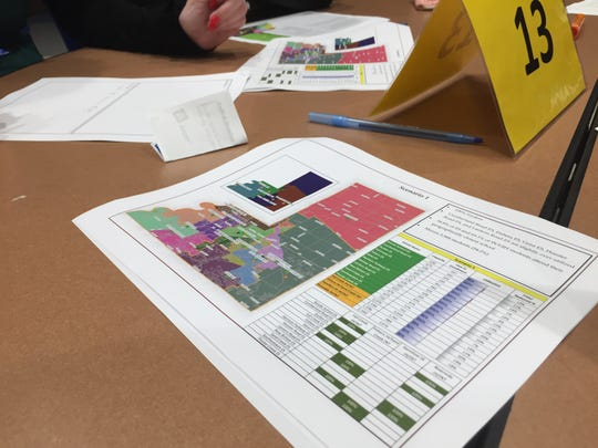 """Parents go over three redistricting scenarios for Hamilton Southeastern Schools during a """"community dialogue"""" on Oct. 24 at Fishers High School."""
