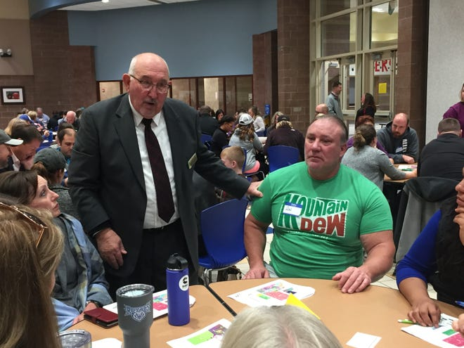 "Hamilton Southeastern Schools' interim assistant superintendent Bill Carnes talks with parents, including Ron Nicodemus, right, during a ""community dialogue"" on Oct. 24 at Fishers High School. Parents offered feedback on three K-8 redistricting options."