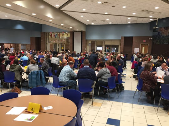 "Parents gather for the first of two ""community dialogues"" to discuss Hamilton Southeastern School's three redistricting options on Oct. 24 at Fishers High School."
