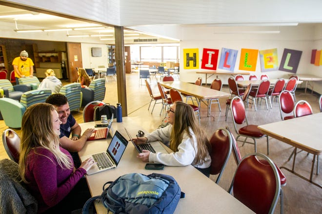 University of Iowa students Brendan Sigale, of Bolingbrook, Illinois, Anna Mazure and Shannon Regan both of Hinsdale, Illinois, study together on Monday, Oct. 29, 2018, at the Hillel House on Market Street in Iowa City.