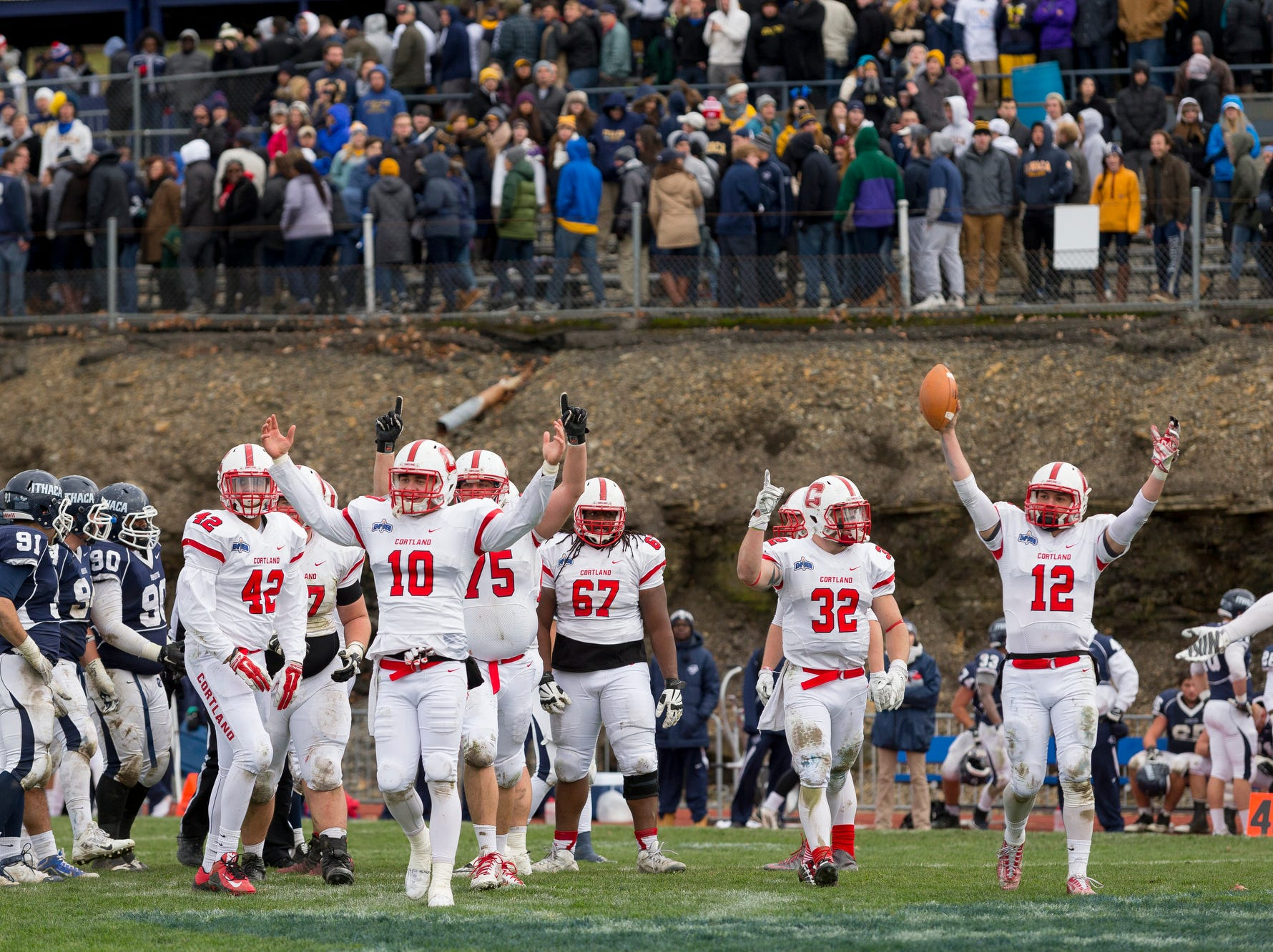 2015: Cortland players celebrate as time runs out in their 11-8 Cortaca Jug win over Ithaca College Saturday afternoon in Ithaca.