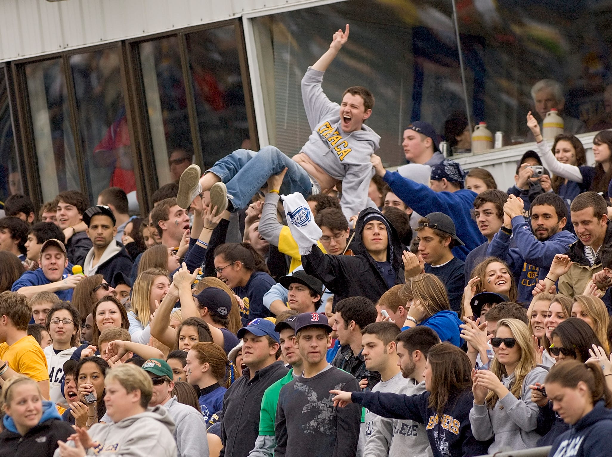 2009: Ithaca College fans celebrate the first touchdown of the game Saturday afternoon during the annual Cortaca Jug game against Cortland.