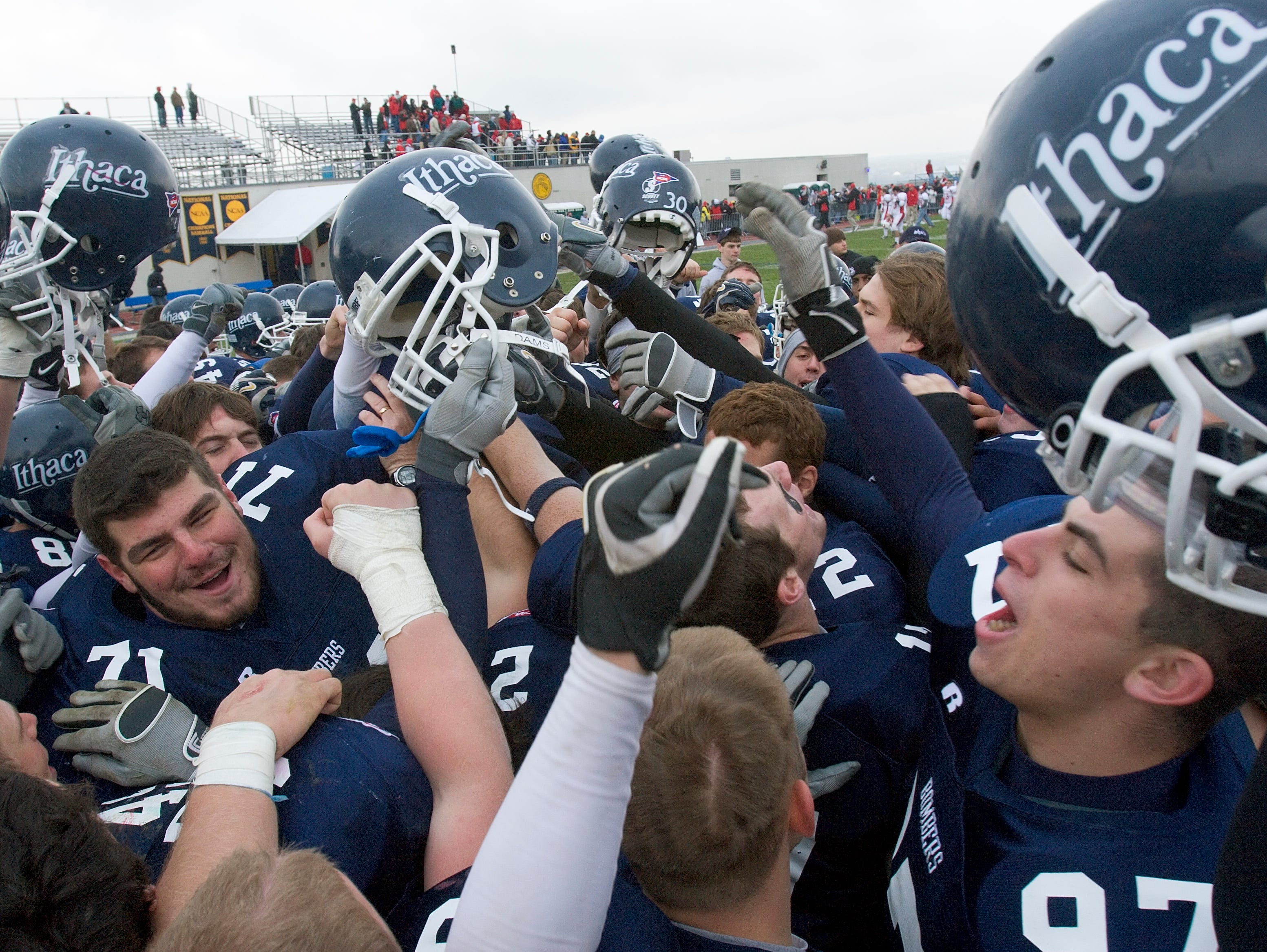 2007: The Ithaca College BomberÕs celebrate after their 40-17 win over Courtland State College after the Cortaca Jug Saturday afternoon at Butterfield Stadium in Ithaca.