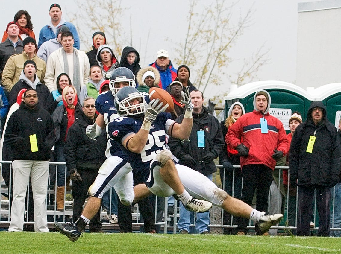 2007: Ithaca CollegeÕs Ryan Terlecki, 25, intercepts a Courtland State pass in the third quarter of play on the BomberÕs own two yard line Saturday afternoon during the Cortaca Jug at Butterfield Stadium in Ithaca. Teammate Scott Lieber, 18, looks on.