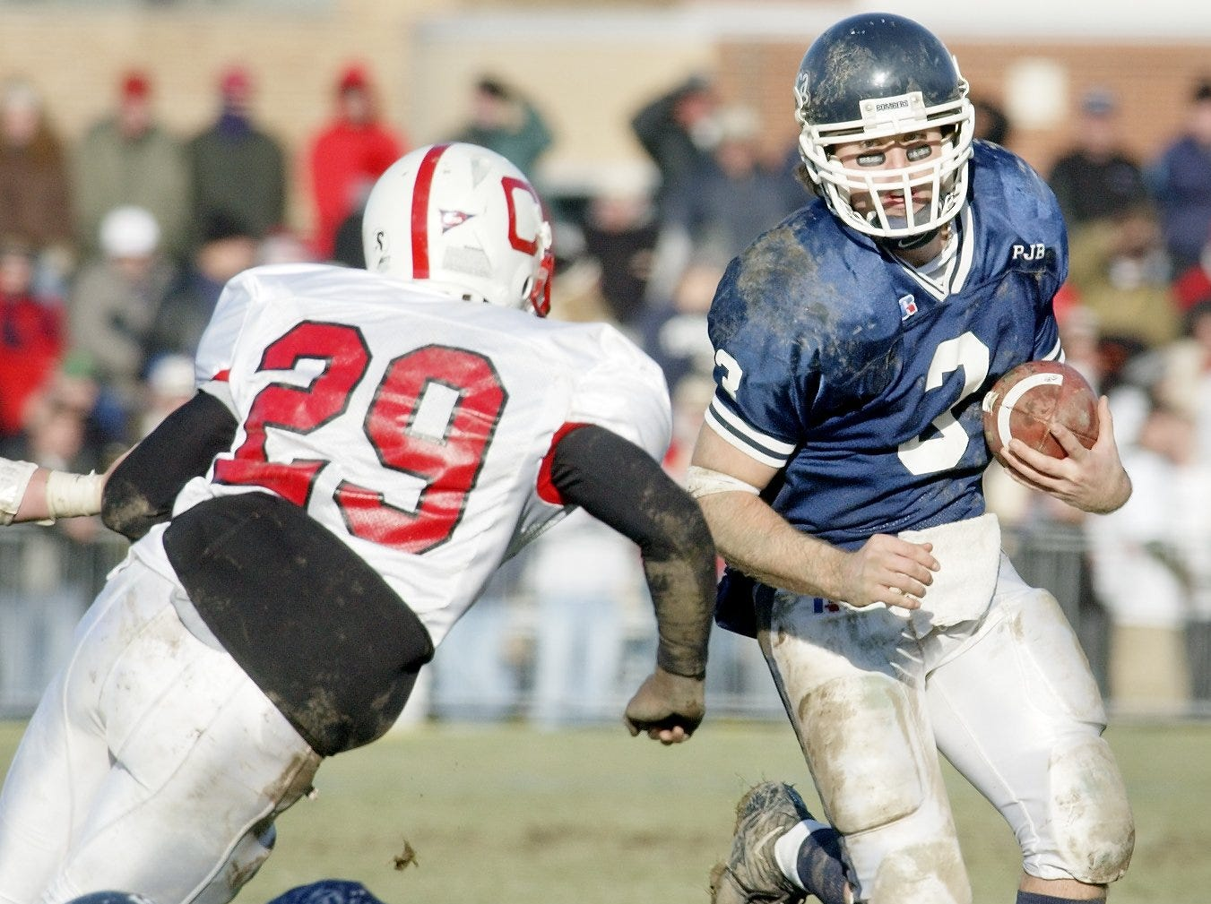 2003: IC's Josh Felicetti, 3, runs downfield as Cortland's Stef Sair, 29, defends during the Cortaca Jug game Nov. 15. The Bombers, 8-2 after last week's 16-15 loss to Cortland, are back in the NCAA playoffs for the second time in three years.