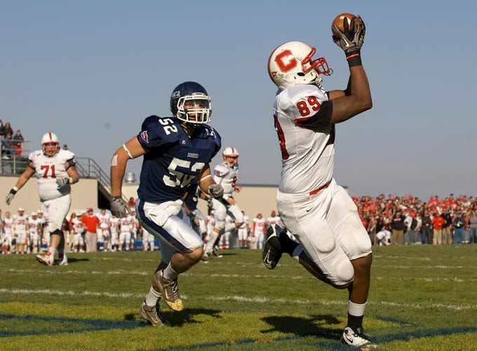 2011: Cortland's Tyreek Burwell catches as pass in the end zone to make the score 6-3 as Ithaca' Jake Santora can't keep up in the second quarter during the annual Cortaca Jug game at Ithaca College.