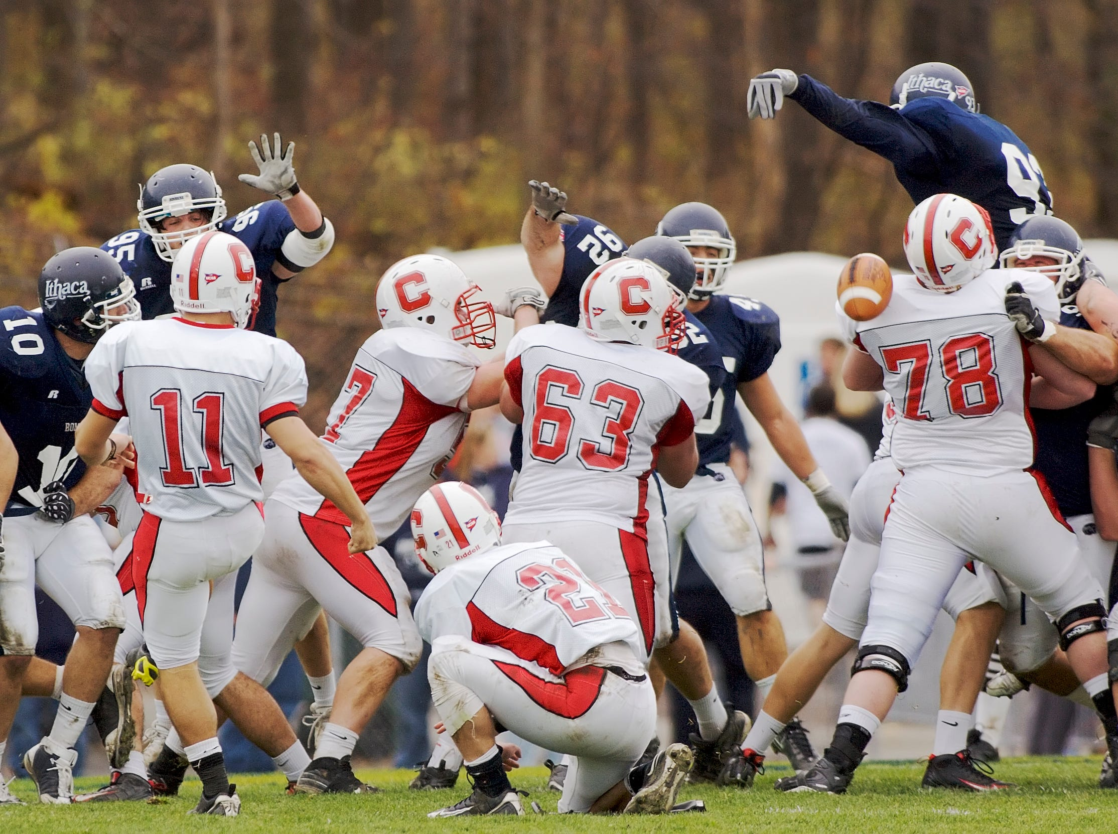 2009: Ithaca's Adam Drescher, top right blocks the extra point kick by Marc Corrado, left after Cortland scored their first touchdown Saturday afternoon during the annual Cortaca Jug game. Holder Wayne Wheeler center picked up the ball, but he was unable to run or pass the ball.