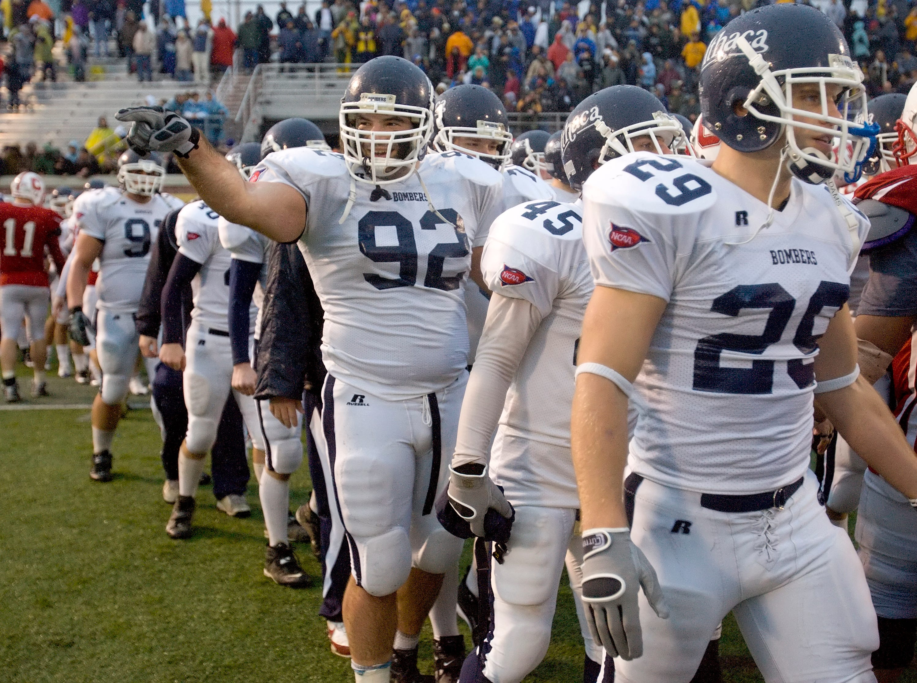 2008: Ithaca College defensive tackle Joe Goetz points toward a friend in the crowd after the Bombers won last year's Cortaca Jug game at SUNY Cortland, 35-13. The two teams will renew their longstanding rivalry at noon Saturday at Butterfield Stadium. The game is already sold out.