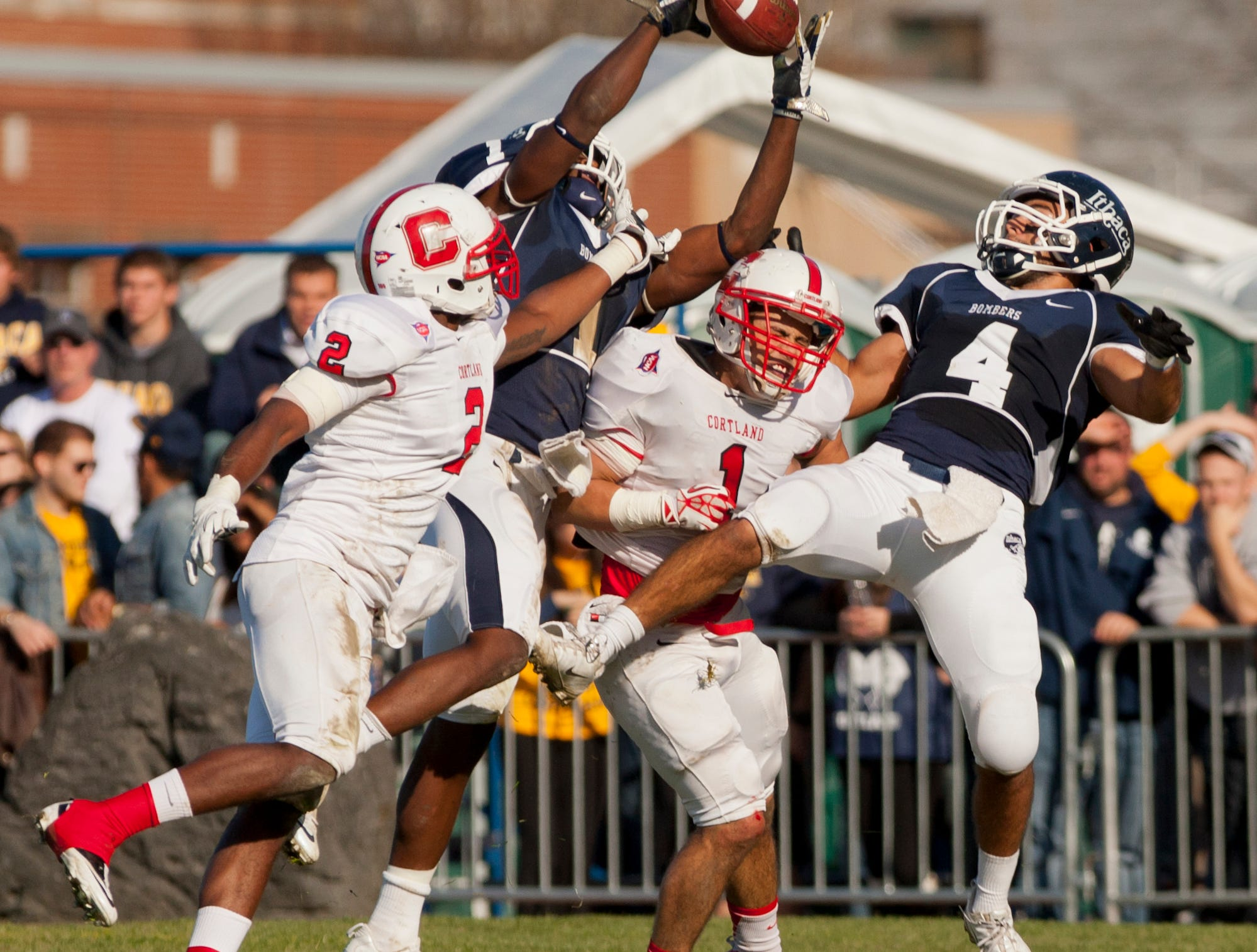2013: From left Cortland's Ke'shaun Stallworth defends as Ithaca's Joel Lynch tries of hang on to a pass in the end zone as time expires in the second quarter with Cortland's Andrew Tolosi and Ithaca's Vito Boffoli, also battling for position under the 42 yard pass attemptSaturday afternoon during the annual Cortaca Jug game at Butterfield Stadium at Ithaca College. L