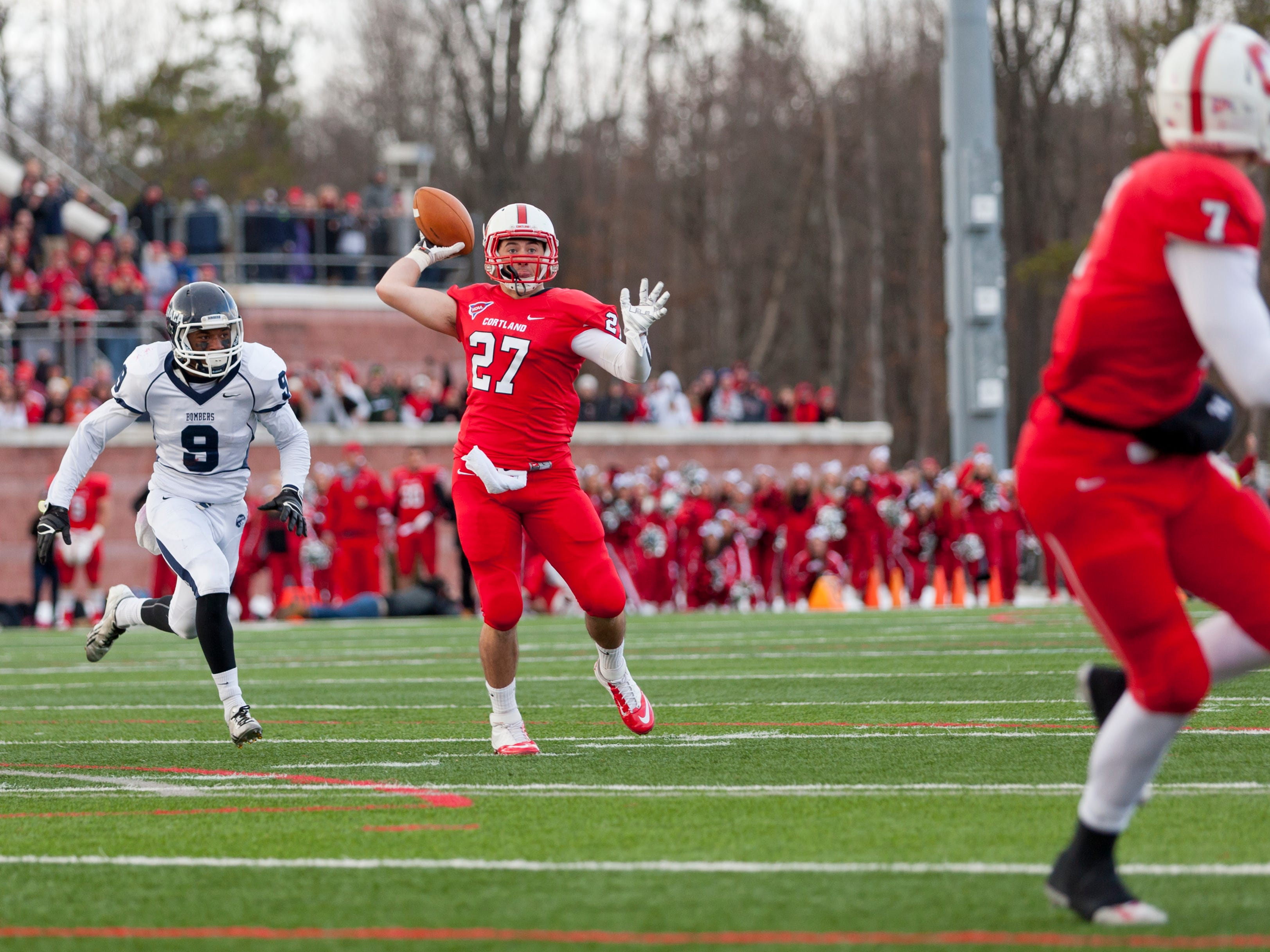 Ithaca's John D'Onofrio can't catch up as Cortland's Luke Hinton throws the winning touchdown to Jon Mannix  as time expires Saturday afternoon during the annual Cortaca Jug game. Cortland won 23-20.