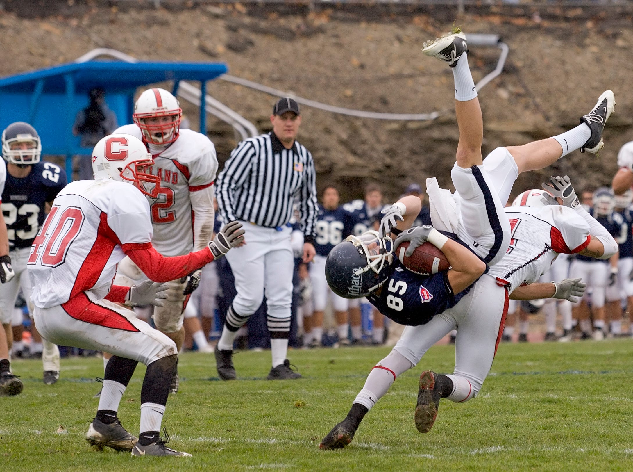 2009: Cortland's Phil Bossman, left watches as Ithaca's Joseph Ingrao hangs on for a pass completion as D. J. Romano upsets him after a leaping catch Saturday afternoon during the Cortaca Jug game.