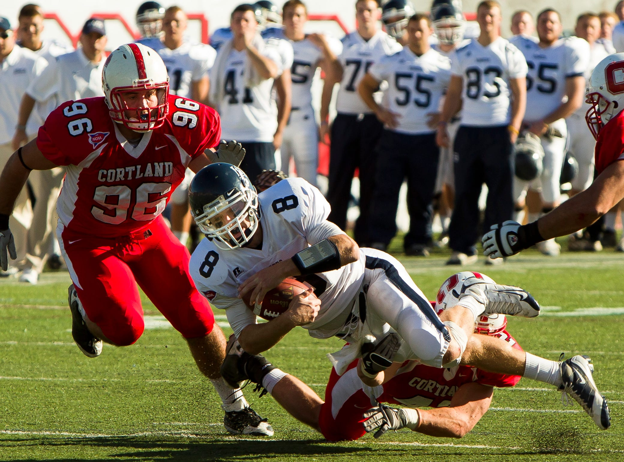 2010: Ithaca College's Rob Zappia is tackled by SUNY Cortland's Cody Allen and Connor Tompkins during Saturday's Cortaca Jug in Cortland.