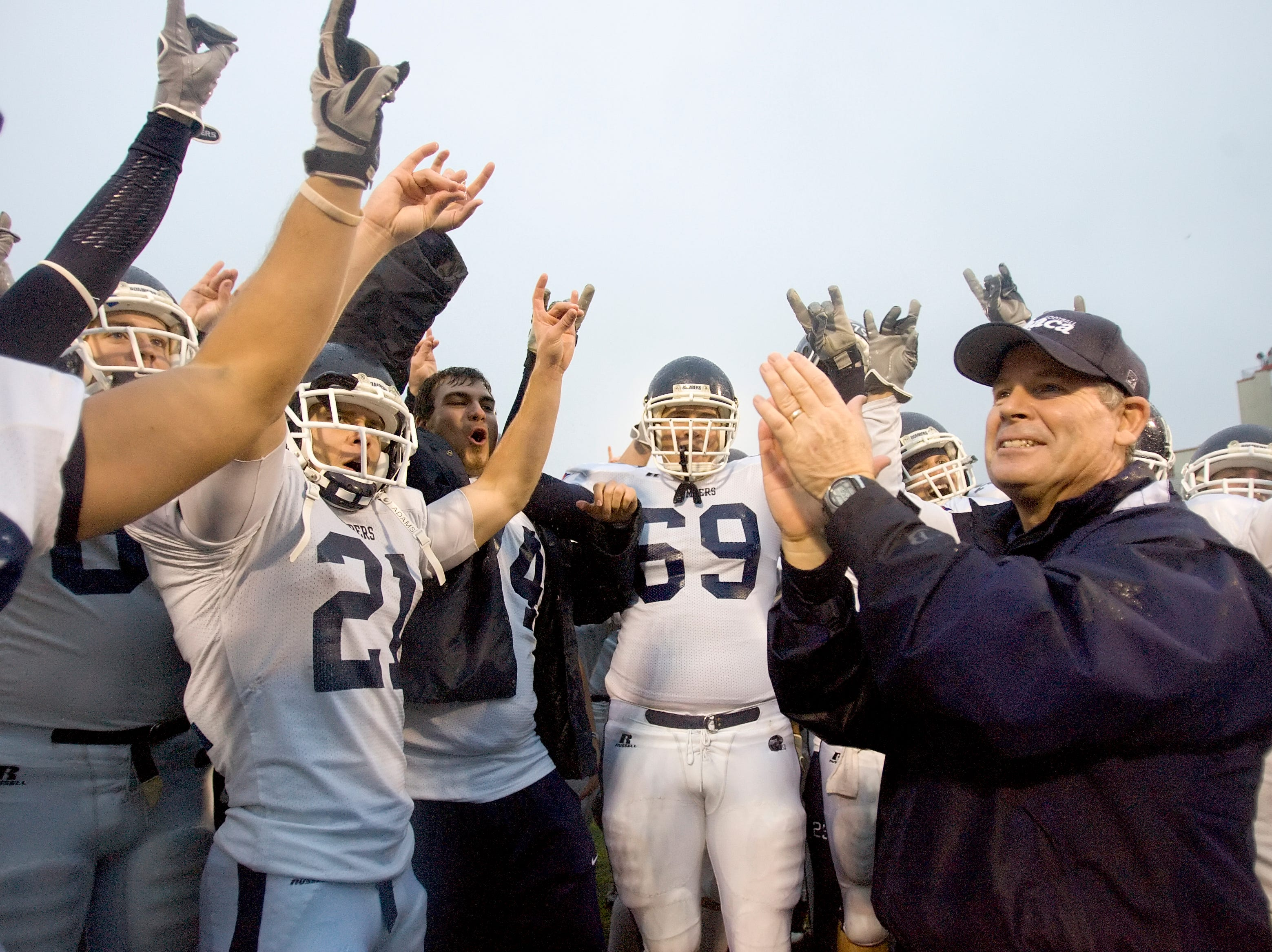 2008: Ithaca College Football Head Coach Mike Welch, right, and his team, the Bombers, celebrate their victory against Cortland on Saturday during the Cortaca Jug at SUNY Cortland.