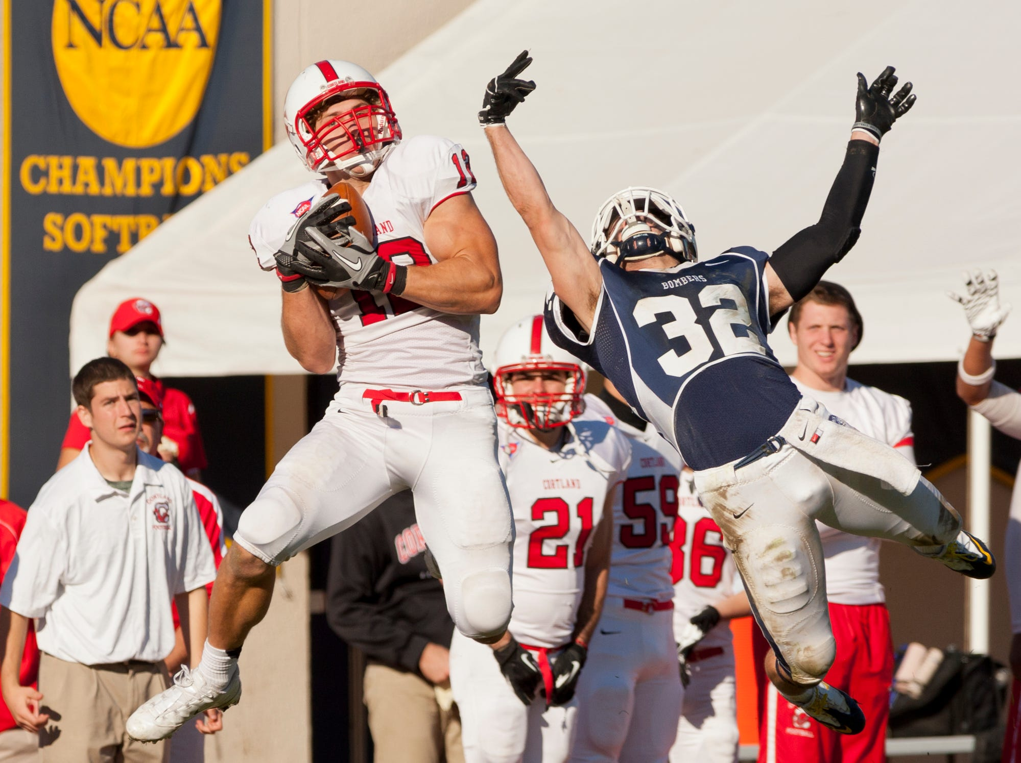 2013: Cortland's John Babin catches the ball for a 63 yard touchdown play making the score 20-14 in the third quarter as Ithaca's Brian Garvey defends Saturday afternoon during the annual Cortaca Jug game at Butterfield Stadium at Ithaca College.