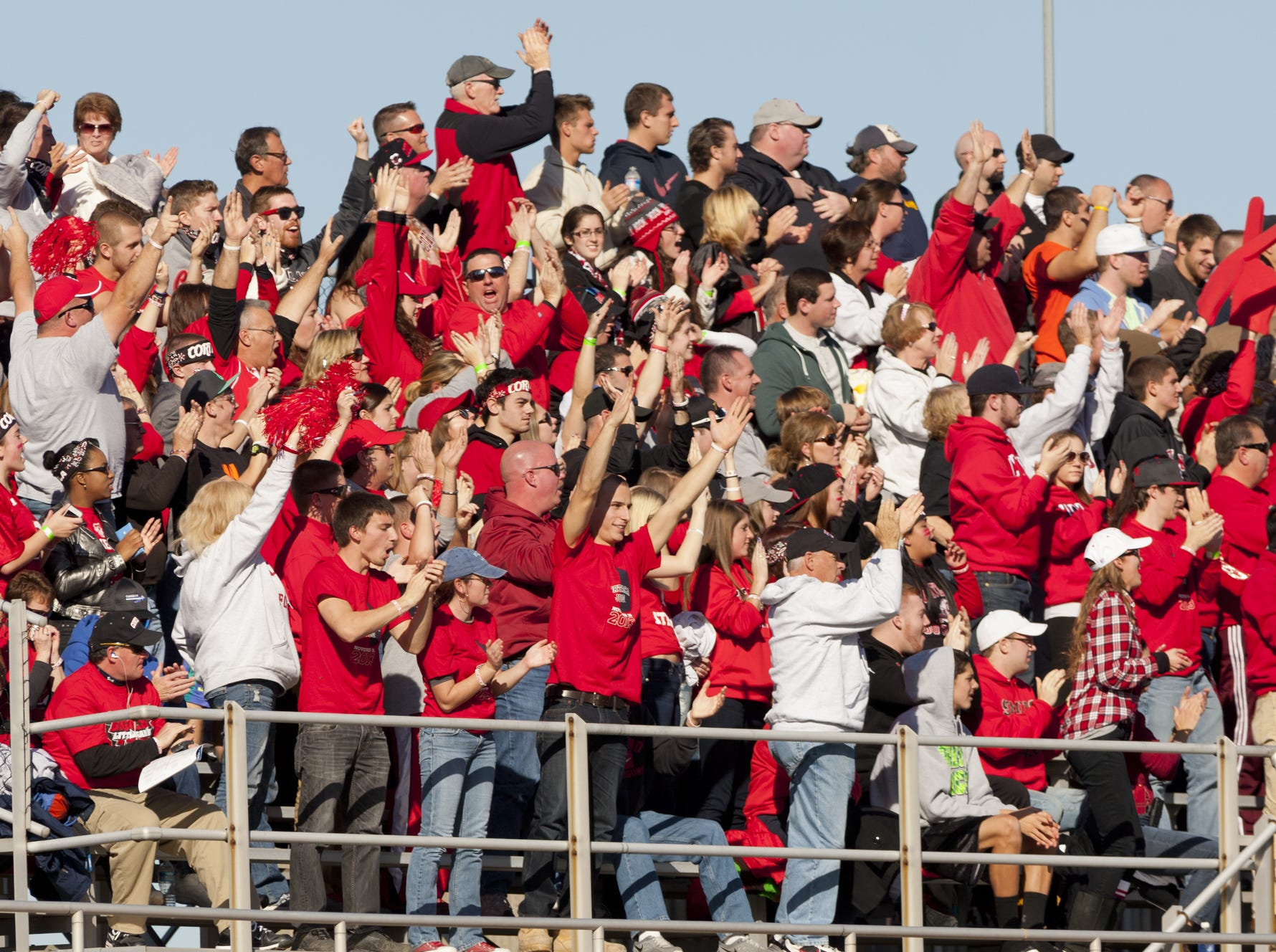 2013: SUNY Cortland fans cheer Saturday afternoon during the annual Cortaca Jug game at Butterfield Stadium at Ithaca College. Cortland defeated Ithaca 28-24.