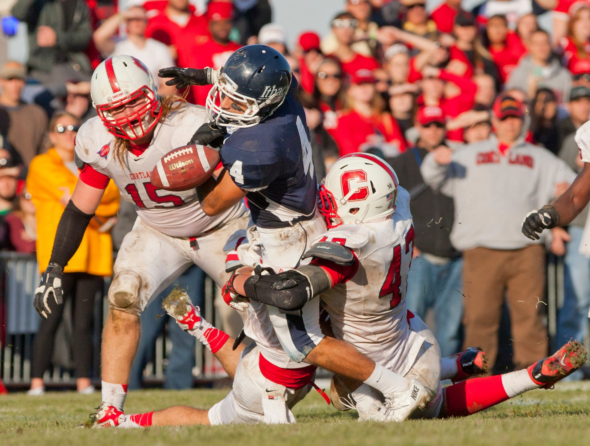 2013: Cortland's Joe DeLuca, left, watches as Ithaca College's Vito Boffoli, center, has the ball stripped by Cortland's Tom Hagan, right, after the initial hit by Andrew Tolosi, obscured, low, after a pass completion from the Cortland 49 yard line with less than 30 seconds remaining in the  annual Cortaca Jug game at Butterfield Stadium at Ithaca College.