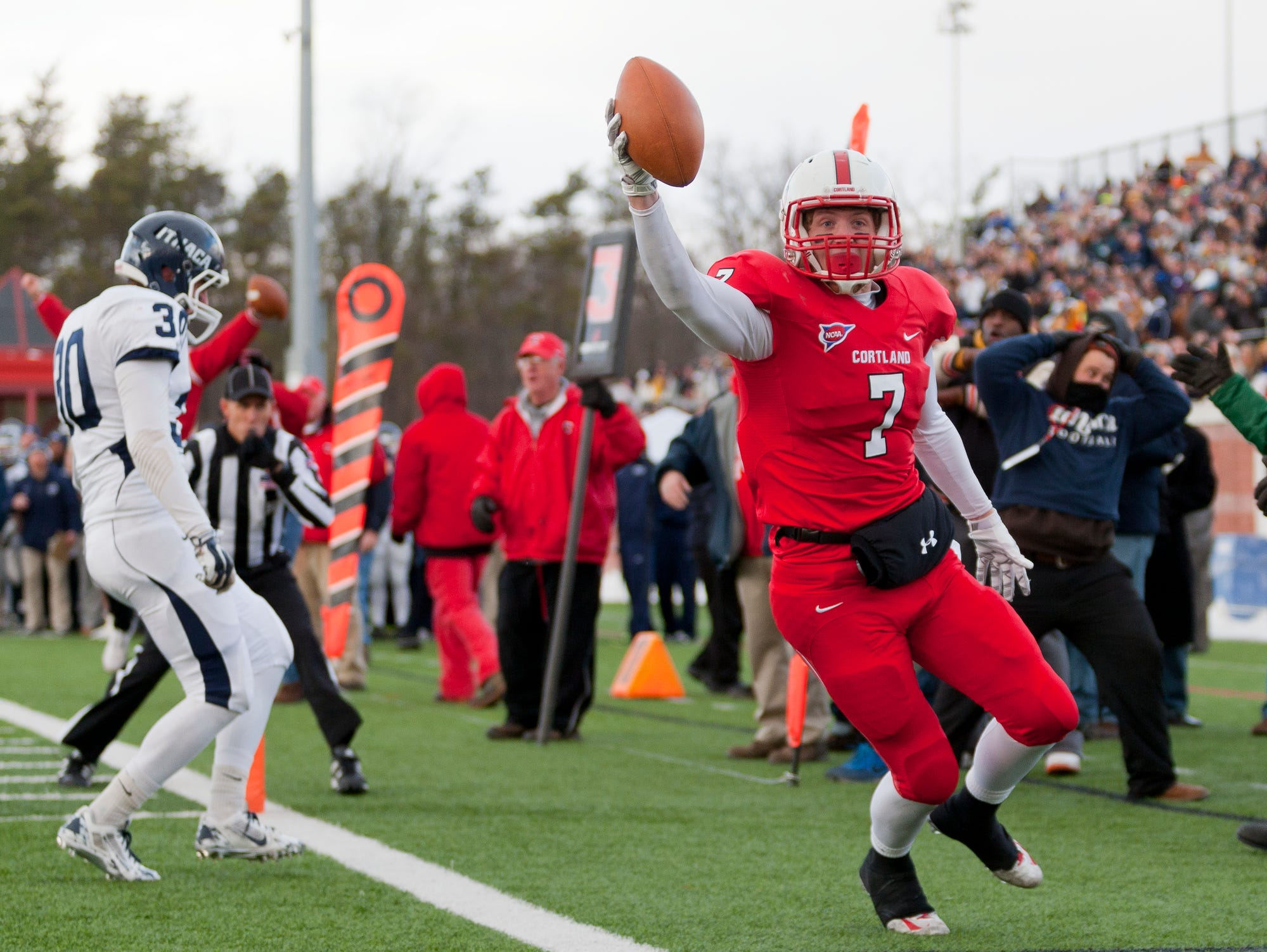 2014: Cortland's Jon Mannix celebrates after catching the winning touchdown as time expired for Cortland to beat Ithaca 23-20 in the annual Cortaca Jug game Saturday in Cortland.