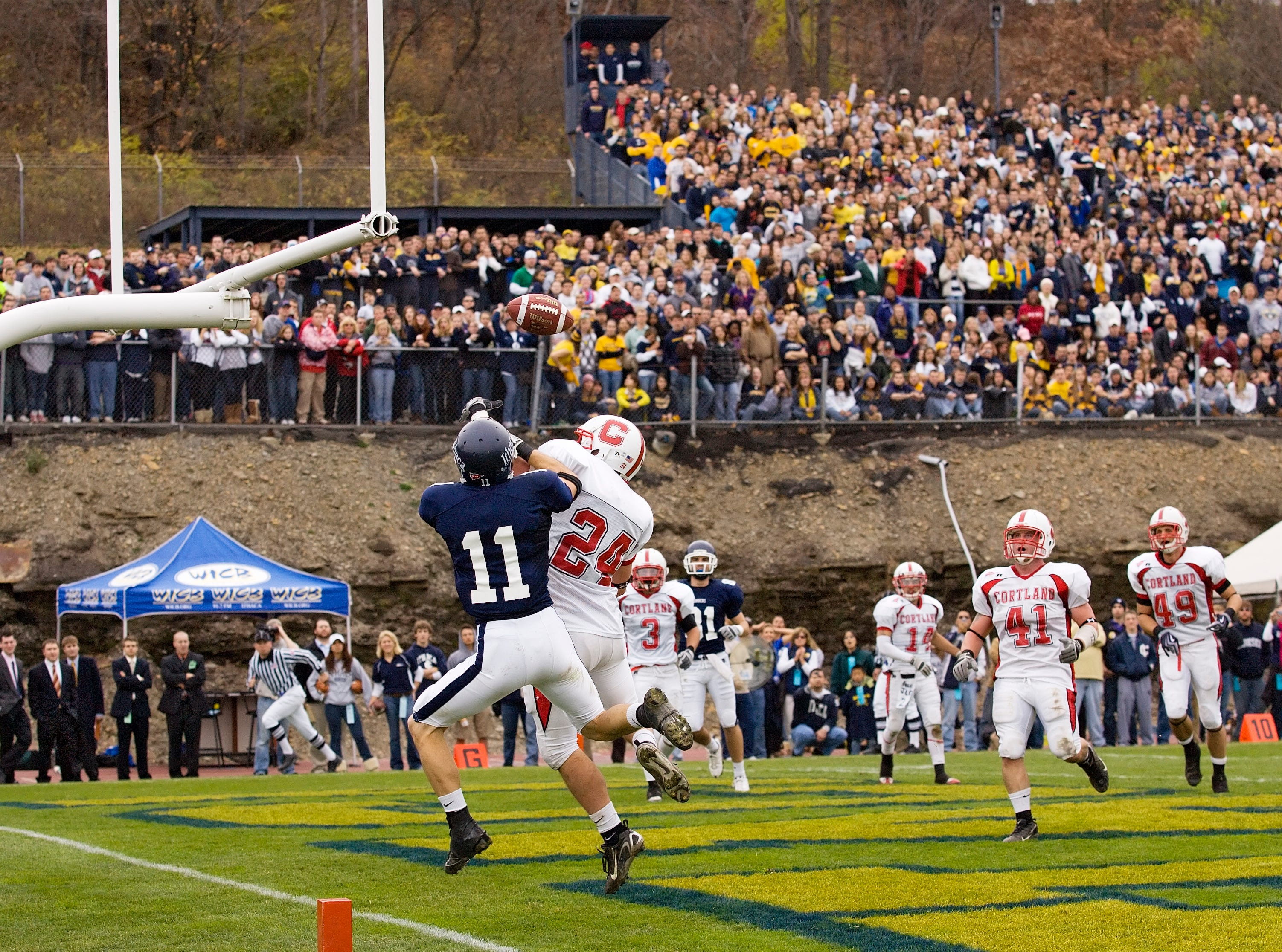 2009: IC receiver Thomas Vossler and Cortland linebacker Colan Shue leap for a pass in the end zone of last year's game.
